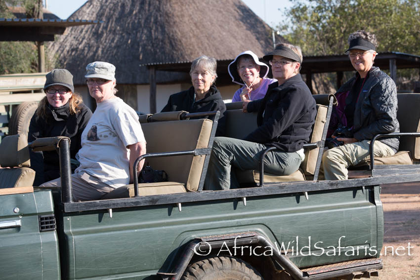 Guests on morning game drive , late September